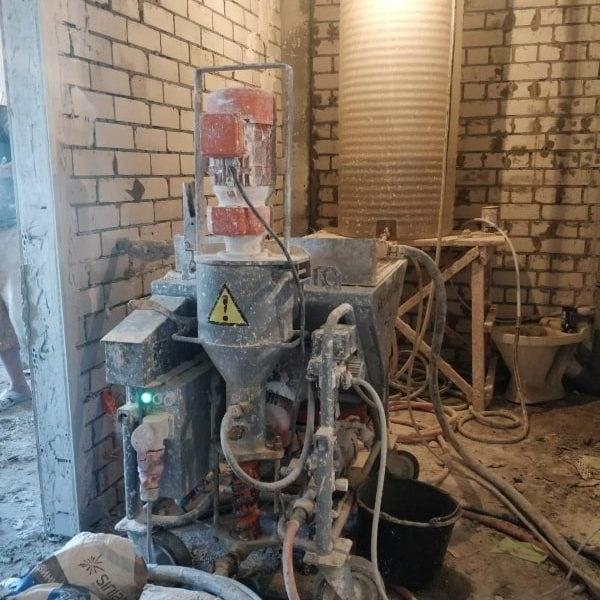 Автомат для машинной штукатурки стен в квартире